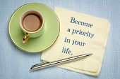 Become a priority in your life - inspirational handwriting on napkin with a cup of coffee poster