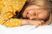 Closeup Image Of Happy Little Girl Lying On The Blanket, Smiling And Laughing With Closed Eyes. Ador poster