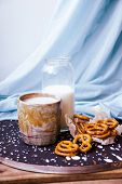 Handmade Ceramic Cup. Coffee, Pretzels And A Bottle Of Milk On A Blue Textile Background. Handmade T poster
