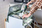 People In Technician Jobs. Appliance Repair Technician Or Handyman Works On Broken Dishwasher In A K poster