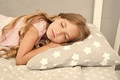 Healthy Sleep Tips. Girl Sleep On Little Pillow Bedclothes Background. Kid Long Curly Hair Fall Asle poster