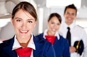 stock photo of work crew  - Air hostess with the airplane cabin crew smiling - JPG