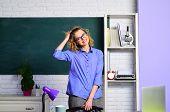Back To School. Beautiful Teacher Standing In Classroom. Student In College. Teacher In Classroom. S poster