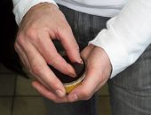stock photo of snuff  - Man taking snuff from a box in doors - JPG