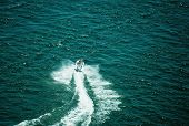 stock photo of waverunner  - a personal watercraft racing down the Colorado river  - JPG