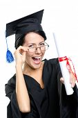 stock photo of school-leaver  - Graduating student in glasses with the diploma adjusts the glasses - JPG