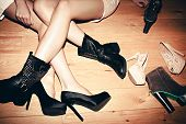 stock photo of black heel  - urban girls with their shoes indoor shot - JPG