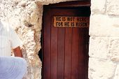 stock photo of he is risen  - the entrance door to the tomb of jesus - JPG