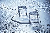 pic of ice-cubes  - Melting ice cubes on a blue metal tabletop - JPG