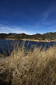stock photo of gross  - Dry Colorado Grasslands and Water Reservoir  - JPG