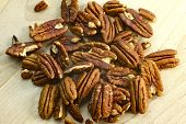 stock photo of pecan tree  - Fresh Pecans on the Wood Kitchen Board - JPG