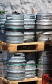pic of keg  - Lots of metal barrels beer kegs on the wooden palettes at factory brewery