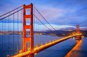 stock photo of gate  - view of famous Golden Gate Bridge by night in San Francisco California USA - JPG