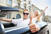 foto of driver  - Car driver happy giving thumbs up  - JPG