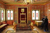 Tourists Look At Throne In Great Wooden Palace