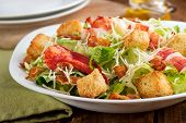 stock photo of shredded cheese  - A crisp green lobster caesar salad with shredded parmesan cheese crispy bacon and herb croutons - JPG
