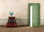 pic of old suitcase  - Vintage interior with set of travel bags and globe near the front door  - JPG