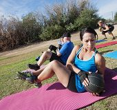 picture of boot camp  - Active diverse group in boot camp fitness class on mats - JPG