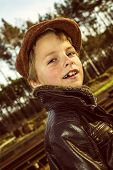 foto of beret  - portrait of a boy wearing vintage clothes and beret - JPG