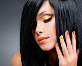 pic of long nails  - portrait of a beautiful woman with red nails and glamour makeup and long black hairs - at studio ** Note: Shallow depth of field - JPG