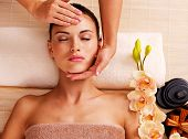 picture of low-necked  - Masseur doing massage the head of an adult woman in the spa salon