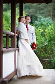 picture of japan girl  - Bride and groom near house of japan style in garden on wedding walk - JPG