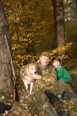 image of laika  - Grandfather grandson and dog hunting in the autumn forest - JPG
