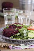 pic of veggie burger  - Vegan burgers with beetroot and beans served with fresh vegetables - JPG