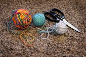 stock photo of rayon  - Detail of balls of yarn and scissors for making crafts - JPG
