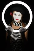 picture of clown rose  - Portrait of a young lady dressed up as a mime isolated over black background - JPG
