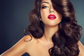 stock photo of long nails  - Model with beautiful curly hair - JPG
