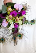 stock photo of female peacock  - Colorful wedding bouquet with peacock feathers - JPG