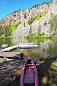 picture of mammoth  - Small red boat on a quiet mountain Mammoth lake - JPG