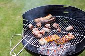 image of barbie  - Barbecue grill filled with grilled meat assortment - JPG