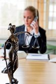 picture of lawyer  - business woman sitting in an office - JPG