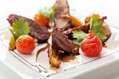 stock photo of roast duck  - Breast of Duck with Roasted Potato Slice and Cherry Tomatoes - JPG