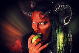 foto of hade  - Portrait of a devil with horns holding apple - JPG