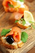 stock photo of canapes  - Canapes with salmon - JPG