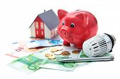 image of piggy  - Heating thermostat with piggy bank and money - JPG