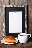 picture of croissant  - Menu board with cup of coffee and croissant on rustic wooden planks background - JPG