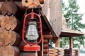 foto of kerosene lamp  - Kerosene lamp hanging on wooden house - JPG