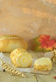 foto of flavor  - A roll of pineapple and almond flavoured soft cheese on rustic board - JPG