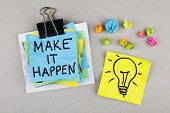 stock photo of motivational  - Make it happen motivating phrase note with light bulb - JPG