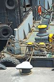 foto of bollard  - Old mooring bollard witp rope on ship - JPG