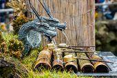 image of metal sculpture  - Close up Metal dragon sculpture with water breathing - JPG