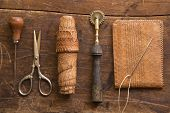 stock photo of wood craft  - Leather craft tools on a wooden background - JPG