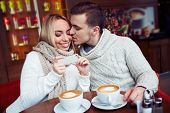 stock photo of sweethearts  - Young sweethearts having rest in cafe - JPG