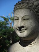 stock photo of gautama buddha  - A stone Buddha statue on the grounds of a temple in Phnom Penh - JPG