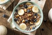stock photo of carbohydrate  - Organic Breakfast Quinoa with Nuts Milk and Berries - JPG