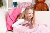 stock photo of belly ache  - Child Suffering From Stomach Ache in the bed - JPG